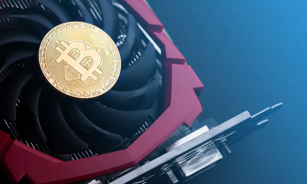 cryptocurrency-mining-concept-with-golden-bitcoin-PLCPQWZ